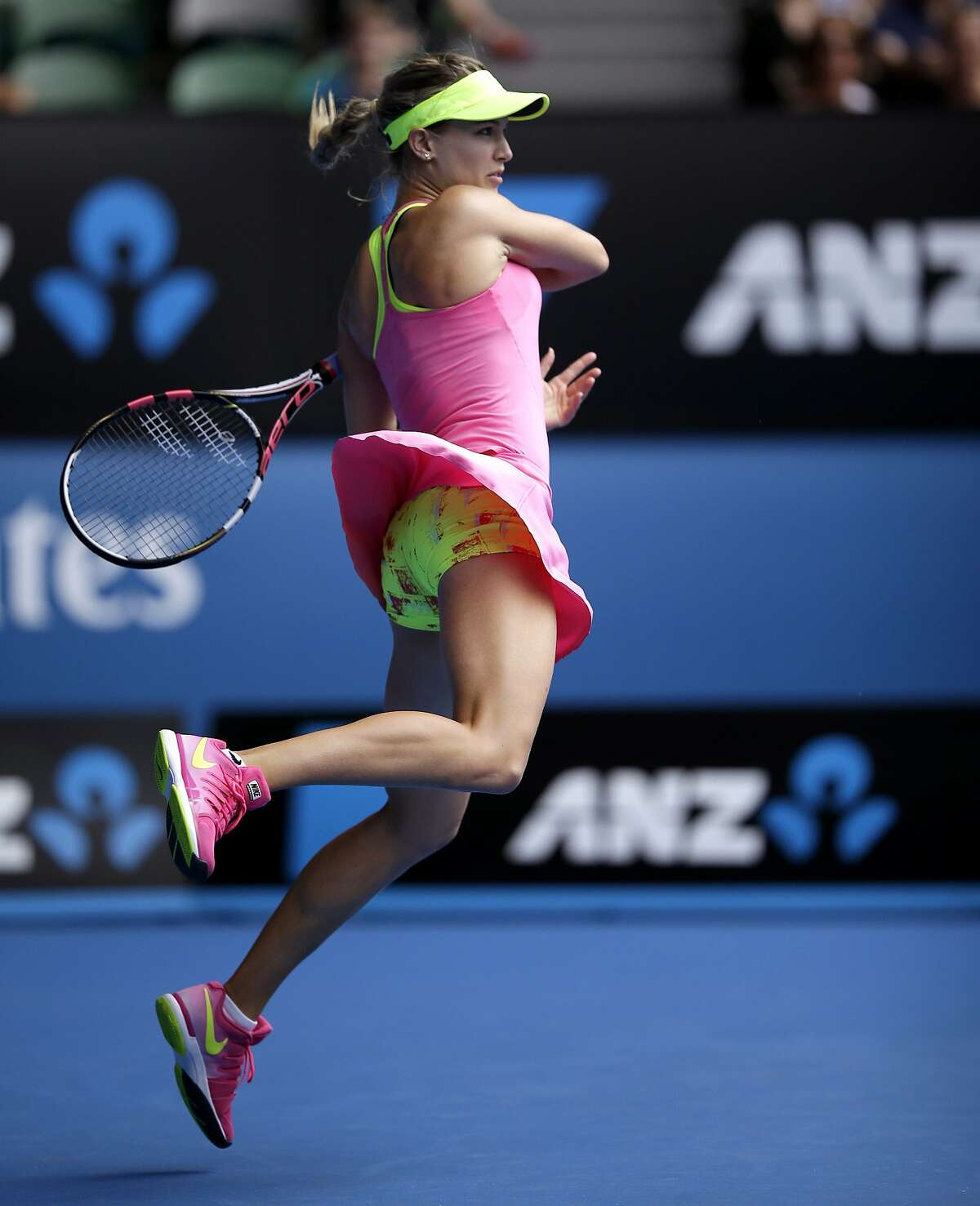CANADIAN CLUB: Eugenie Bouchard slams a shot to Maria Sharapova during their quarterfinal match at the Australian Open in Melbourne. Unfortunately for the young Canadian, Sharapova won in straight sets.