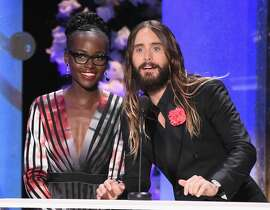 Actors Lupita Nyong'o (L) and Jared Leto speak onstage at TNT's 21st Annual Screen Actors Guild Awards at The Shrine Auditorium on January 25, 2015 in Los Angeles, California. 25184_019