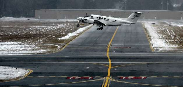 A military aircraft was one of the few aircraft exiting the airport Tuesday morning Jan. 27, 2015 at the Albany International Airport in Colonie, N.Y.        (Skip Dickstein/Times Union) Photo: SKIP DICKSTEIN