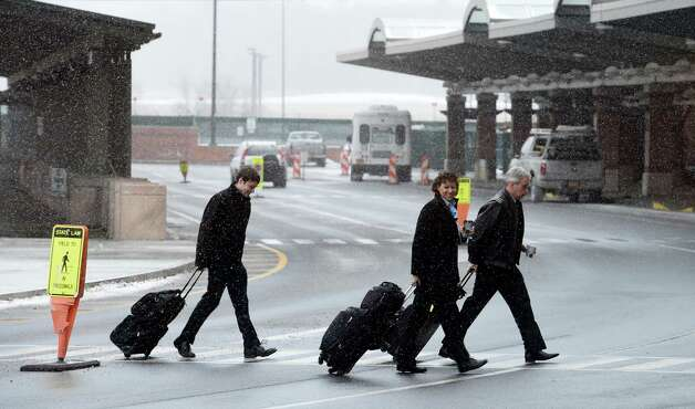 A flight crew arrives Tuesday morning Jan. 27, 2015 at the Albany International Airport in Colonie, N.Y.        (Skip Dickstein/Times Union) Photo: SKIP DICKSTEIN