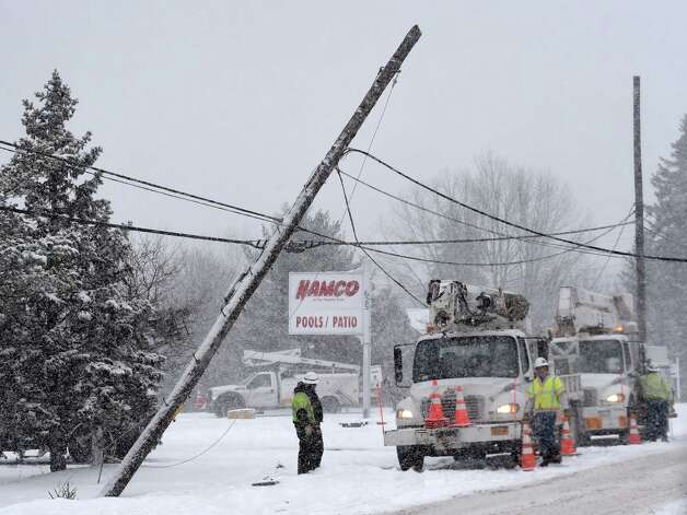 Crews from Verizon and National Grid work to repair a broken utility pole on Route 155 Tuesday afternoon Jan. 27, 2015 in Latham, N.Y.        (Skip Dickstein/Times Union) Photo: SKIP DICKSTEIN