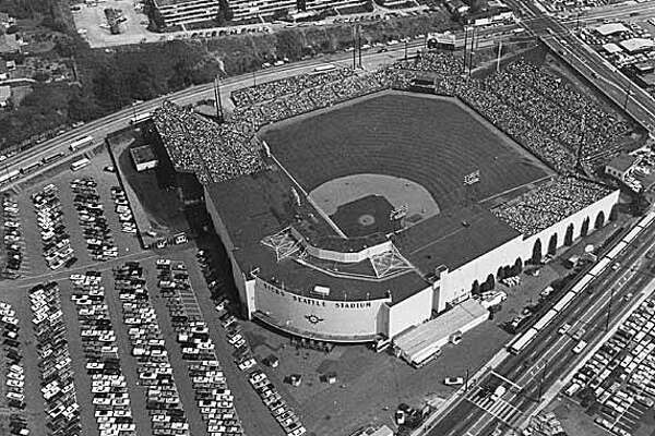 31. Aerial_of_Sicks_Stadium_looking_southeast_Seattle_1969.jpg - Businessman Emil Sick bought the Seattle Indians baseball team in 1937 and renamed it the Seattle Rainiers. He also started work on a new steel and concrete baseball stadium in Rainier Valley, south of downtown. Sick's Seattle Stadium opened in June 1938. For years, fans crowded the stadium or watched from the slopes overlooking the outfield. By the 1960s, fewer people were going to the games. The stadium was torn down in the 1970s. This photo shows Rainier Avene South in the foreground and South McClelland Street in the upper right.