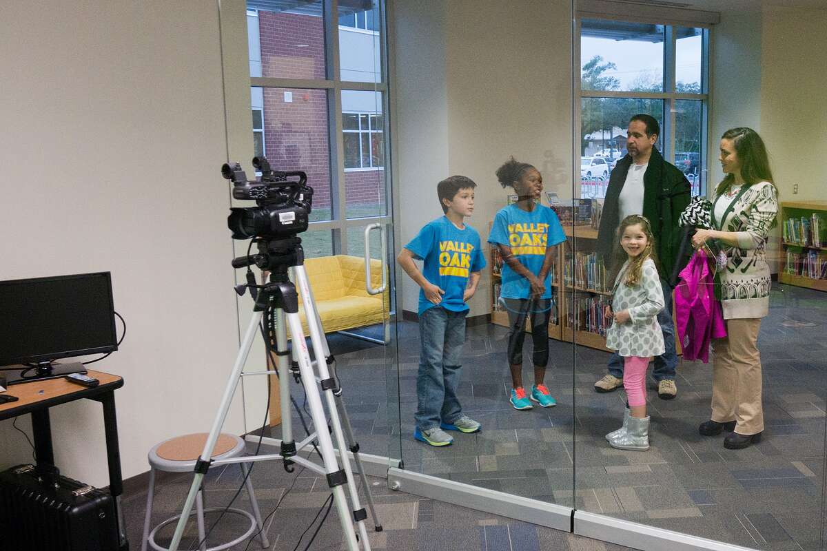 Student tour guides Dominic Bujanos and Grace Delpit, both fifth-graders, show the new TV studio in the library after the grand opening of Valley Oaks Elementary School. The studio, a fishbowl design, will be used in media education programs as well as for broadcast of the school news and announcement programming. Taking the tour are Mercedes Bujanos, a first-grader; John Bujanos and Roxanna Bujanos.Student tour guides Dominic Bujanos and Grace Delpit, both fifth-graders, show the new TV studio in the library after the grand opening of Valley Oaks Elementary School. The studio, a fishbowl design, will be used in media education programs as well as for broadcast of the school news and announcement programming. Taking the tour are Mercedes Bujanos, a first-grader; John Bujanos and Roxanna Bujanos.