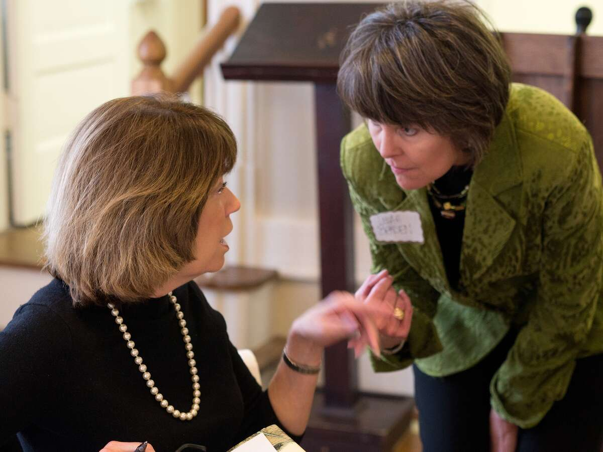 Author Ann Weisgarber talks with Leah Braden during a combined meeting of the Heights, West U, and Southgate book clubs at the Heights Women's Club clubhouse. Photo By R. Clayton McKee