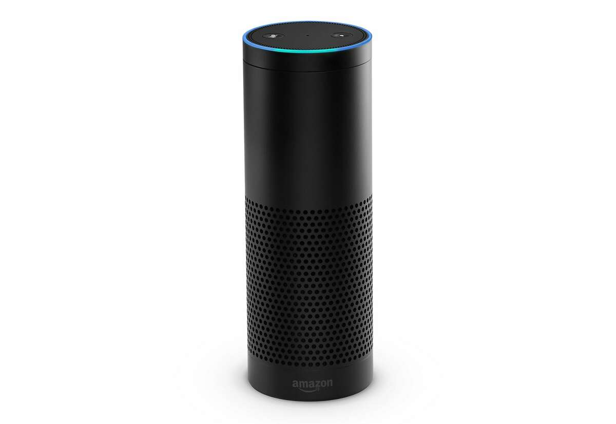This product image provided by Amazon shows the Amazon Echo. The Wi-Fi only speaker-like device, which has an accompanying app for tablets and smartphones, is Bluetooth enabled and can play music from Amazon Prime Music or other music services like iTunes and Spotify. (AP Photo/Amazon)