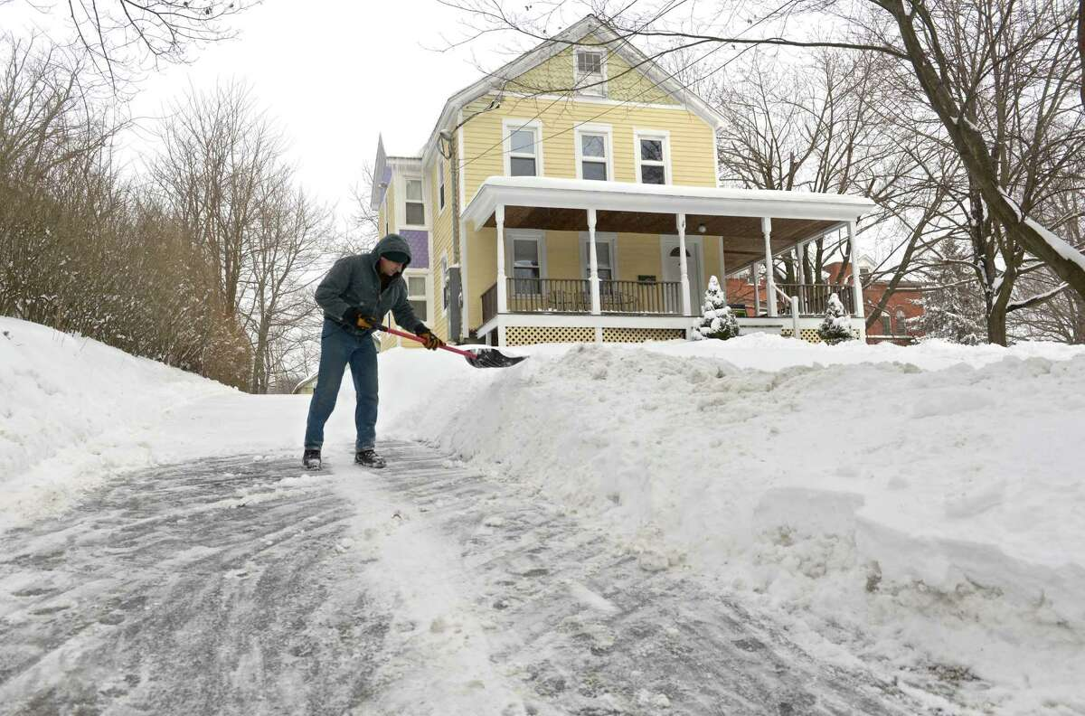 Ricardo Mancini works his way up his driveway as he clears the snow left behind by the snow storm on Tuesday, January 27, 2015. On South Street, in Bethel, Conn.