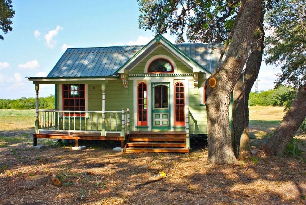 Tiny Texas Houses constructed this 12' by 26' home, Painted Lady, which has a built-in couch and freezer.