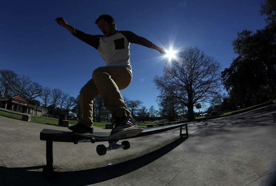 San Antonio College student Nelson Montenegro takes a break from classes to take in the sun and nice weather while skateboarding at San Pedro Park on Tuesday, Jan. 27, 2015. Photo: Kin Man Hui, San Antonio Express-News / ©2015 San Antonio Express-News