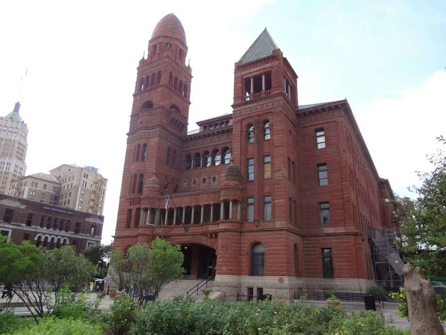 Architect James Riely Gordon designed the red sandstone Bexar County Courthouse in the Romanesque Revival style popular in the late 19th century. Photo: Steve Bennett /San Antonio Express-News