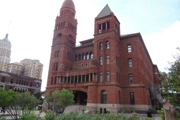 Architect James Riely Gordon designed the red sandstone Bexar County Courthouse in the Romanesque Revival style popular in the late 19th century.