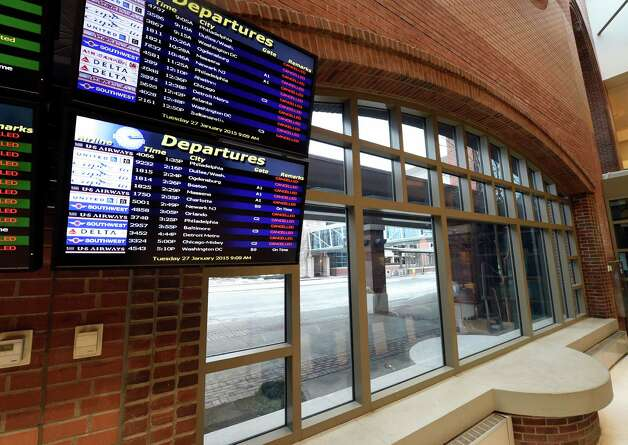 Cancellations were all that could be found of departures at the Albany International Airport Tuesday morning Jan. 27, 2015 in Colonie, N.Y.   Ultimately flights did start to get out later in the day.     (Skip Dickstein/Times Union) Photo: SKIP DICKSTEIN