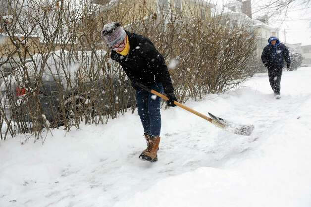 Kathleen Hutcheson of Ancaster, Ont. Canada, left, shovels the walkway at her daughter's home on Tuesday, Jan. 27, 2015, in Albany, N.Y. Hutcheson is visiting her daughter Jamie Hutcheson, who is a student and basketball player at the College of Saint Rose. (Cindy Schultz / Times Union) Photo: Cindy Schultz