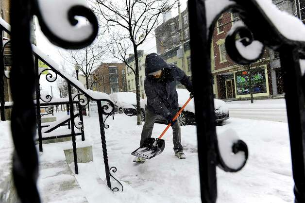 Joseph Fello shovels his neighbor's steps and sidewalk on Lark Street during a snow storm on Tuesday, Jan. 27, 2015, in Albany, N.Y. (Cindy Schultz / Times Union) Photo: Cindy Schultz