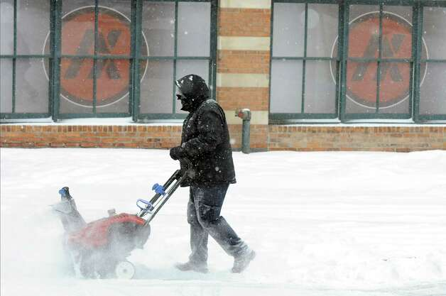 Brian McCarville of Carrow Real Estate Services snow blows a downtown sidewalk on Tuesday, Jan. 27, 2015, in Albany, N.Y. (Cindy Schultz / Times Union) Photo: Cindy Schultz