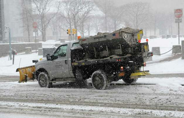 A plow truck dumps salt on State St. outside the Capitol during a snow storm on Tuesday, Jan. 27, 2015 in Albany, N.Y.  (Lori Van Buren / Times Union) Photo: Lori Van Buren