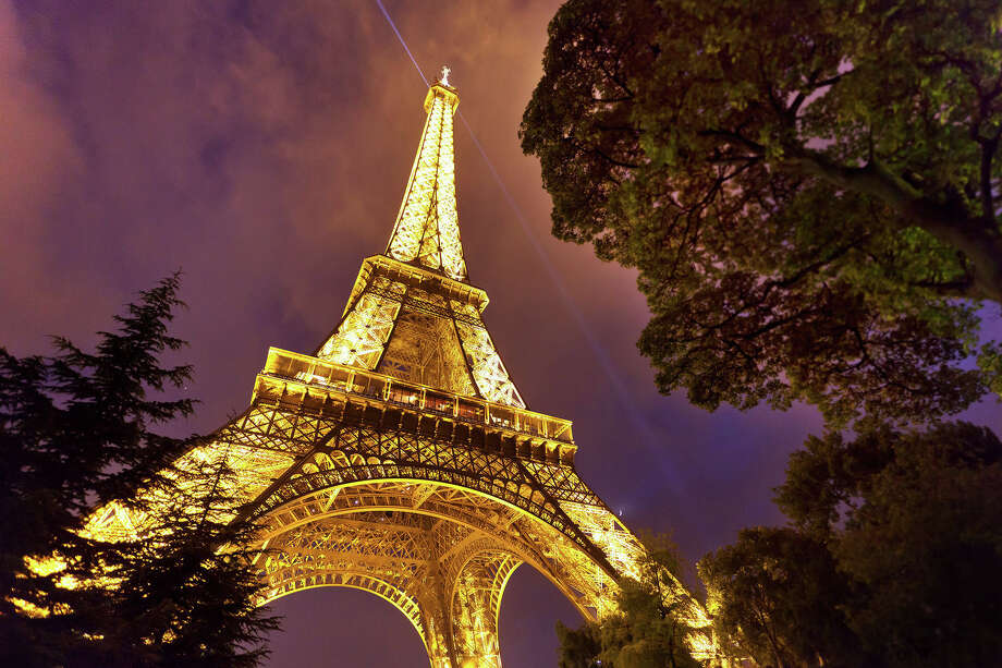 The Eiffel Tower is the granddaddy of travel cliches  - but it's worth it, so go all the way to the top. Photo: Dominic Bonuccelli / dominic arizona bonuccelli / azfoto.com