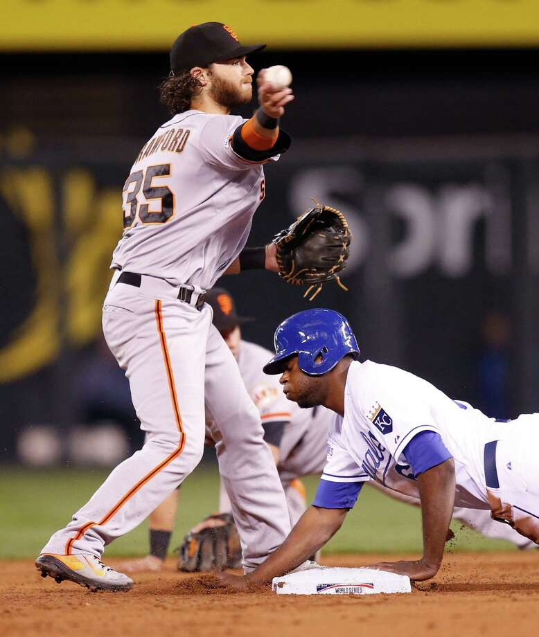 Giants Brandon Crawford turns the double play on Royals Lorenzo Cain and Eric Hosmer in the second inning during Game 7 of the World Series at Kauffman Stadium on Wednesday, Oct. 29, 2014 in Kansas City, Mo. Photo: Michael Macor / The Chronicle / ONLINE_YES