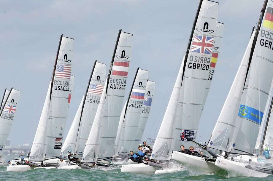Boats in the Nacra 17 class jockey for position at the start during the ISAF Sailing World Cup Miami on Biscayne Bay, Monday, Jan. 26, 2015, in Miami. Sailors from 63 countries are competing in the regatta featuring Olympic and Paralympic class racing.  Photo: Lynne Sladky, Associated Press / AP