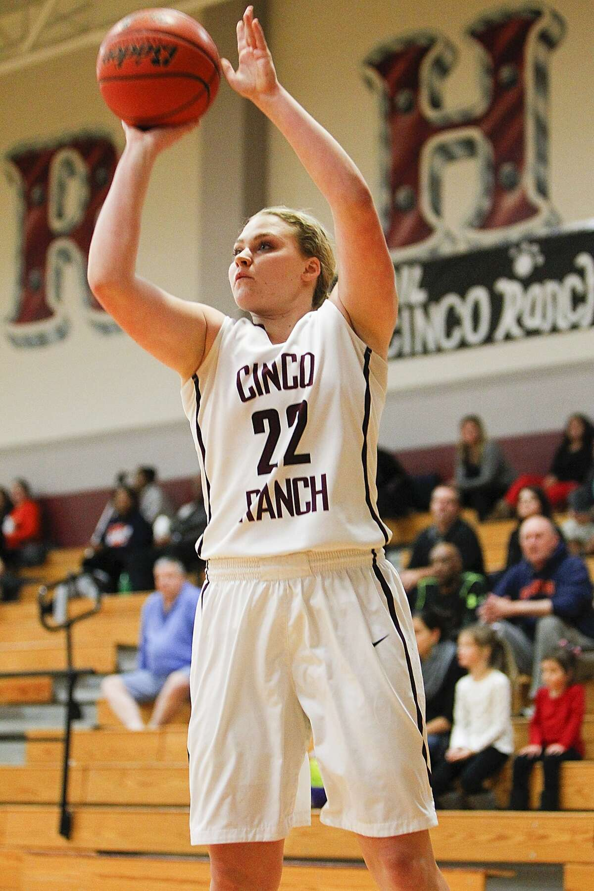 Corin Evans of Cinco Ranch lands a three-pointer during the first period as the Lady Cougars took on Seven Lakes in district play at Cinco Ranch High School in Katy on January 9, 2015.