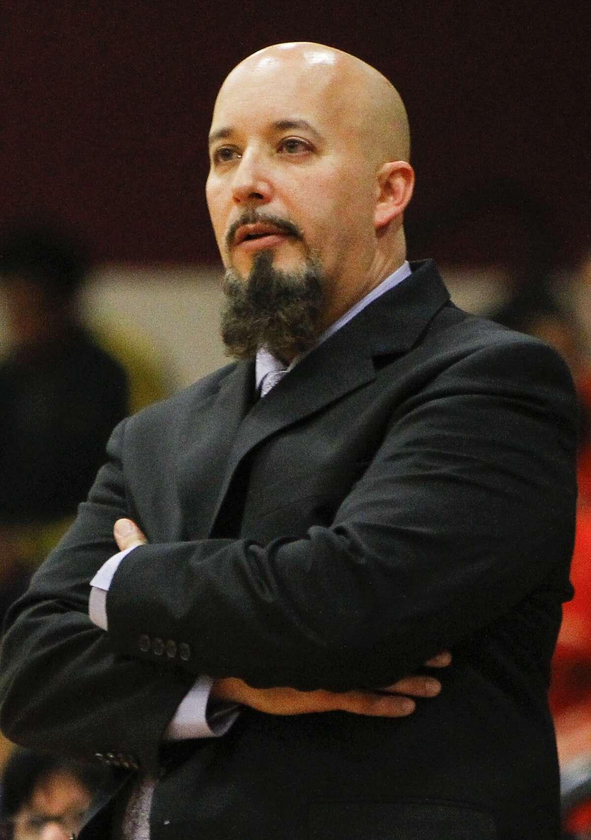 Cinco Ranch girls basketball head coach Carlos Villafone.