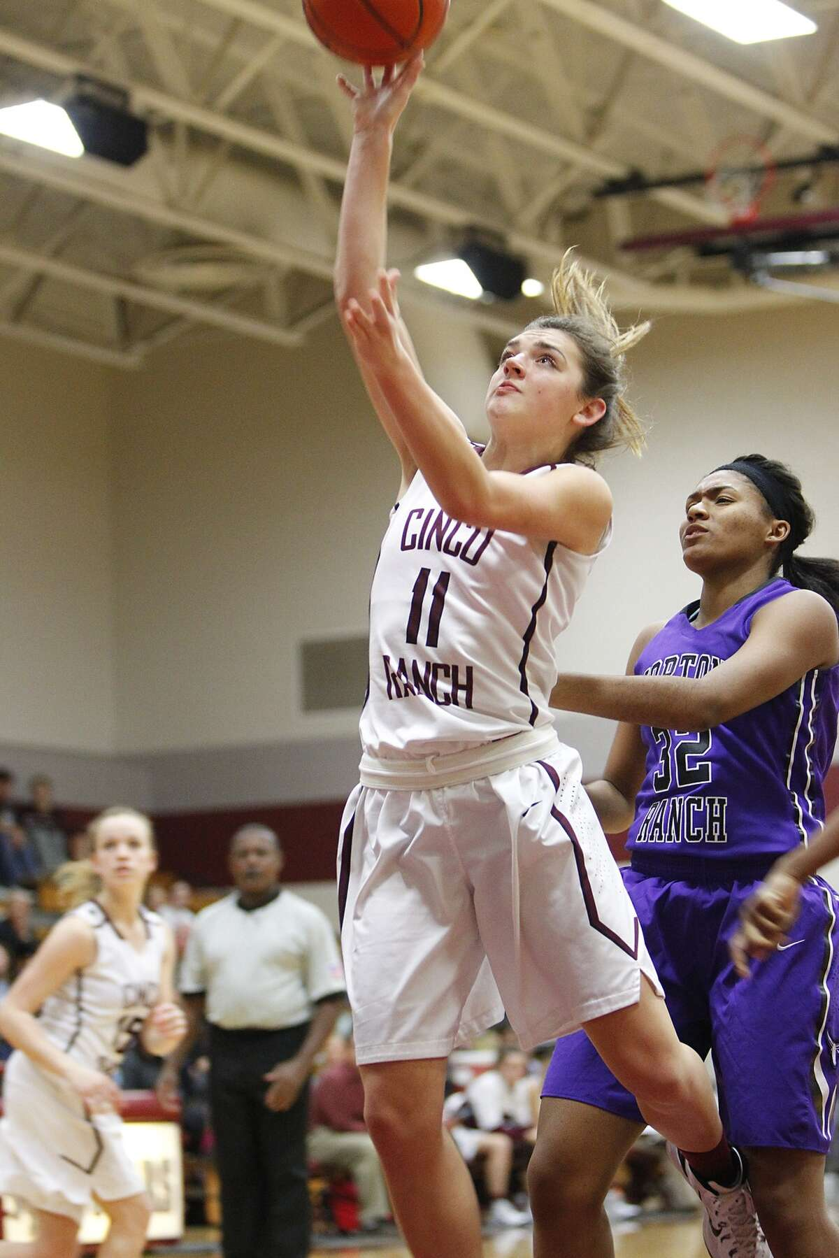Cinco Ranch's Kelly Lynch goes for the layup as the Lady Cougars hosted Morton Ranch at Cinco Ranch High School on January 23, 2015.