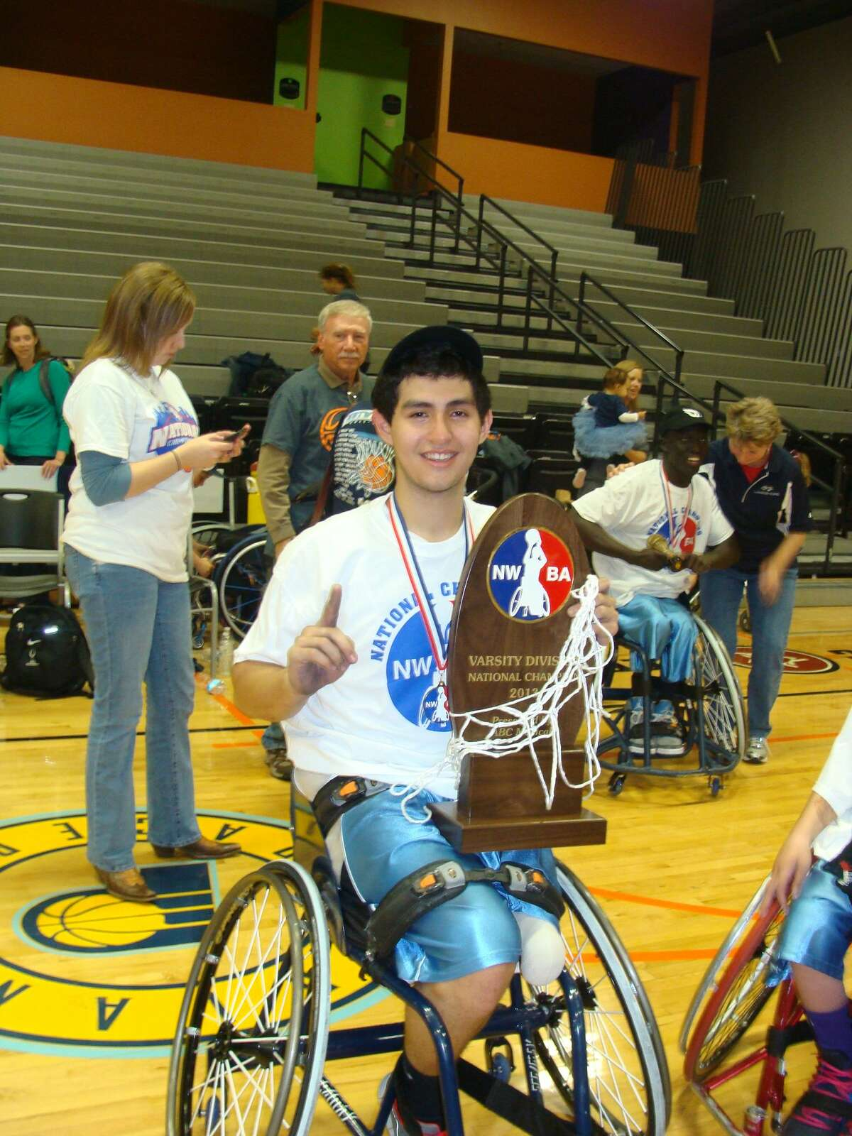 Fort Bend Elkins senior Fabian Romo has signed a scholarship to play wheelchair basketball at UT-Arlington.