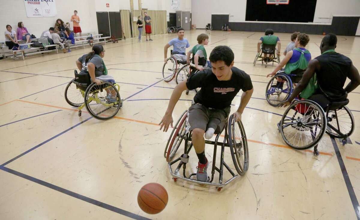 1/12/2013: FabIan Romo with the Tier Hotwheel wheelchair basketball team dribbles the ball during a practice scrimmage at the West Gray Recreation Center in Houston, Texas. We need pictures of Victor Meza, a handicapped basketball athlete profiled in our feature story for Sports in La Voz. We also need pictures of coach Genny Gomez and the rest of the team team at practice at the West Gray Recreation Center. In the case of bad weather, please call coach Gomez (contact info. below) before to make sure as the previous practice during the week was cancelled for that reason. The practice takes place indoors but the kids are handicapped and it is difficult for them to make it there with heavy rain. NOTE******Victor did not show up for practice, he will be at Tuesdays practice if you need me to go.