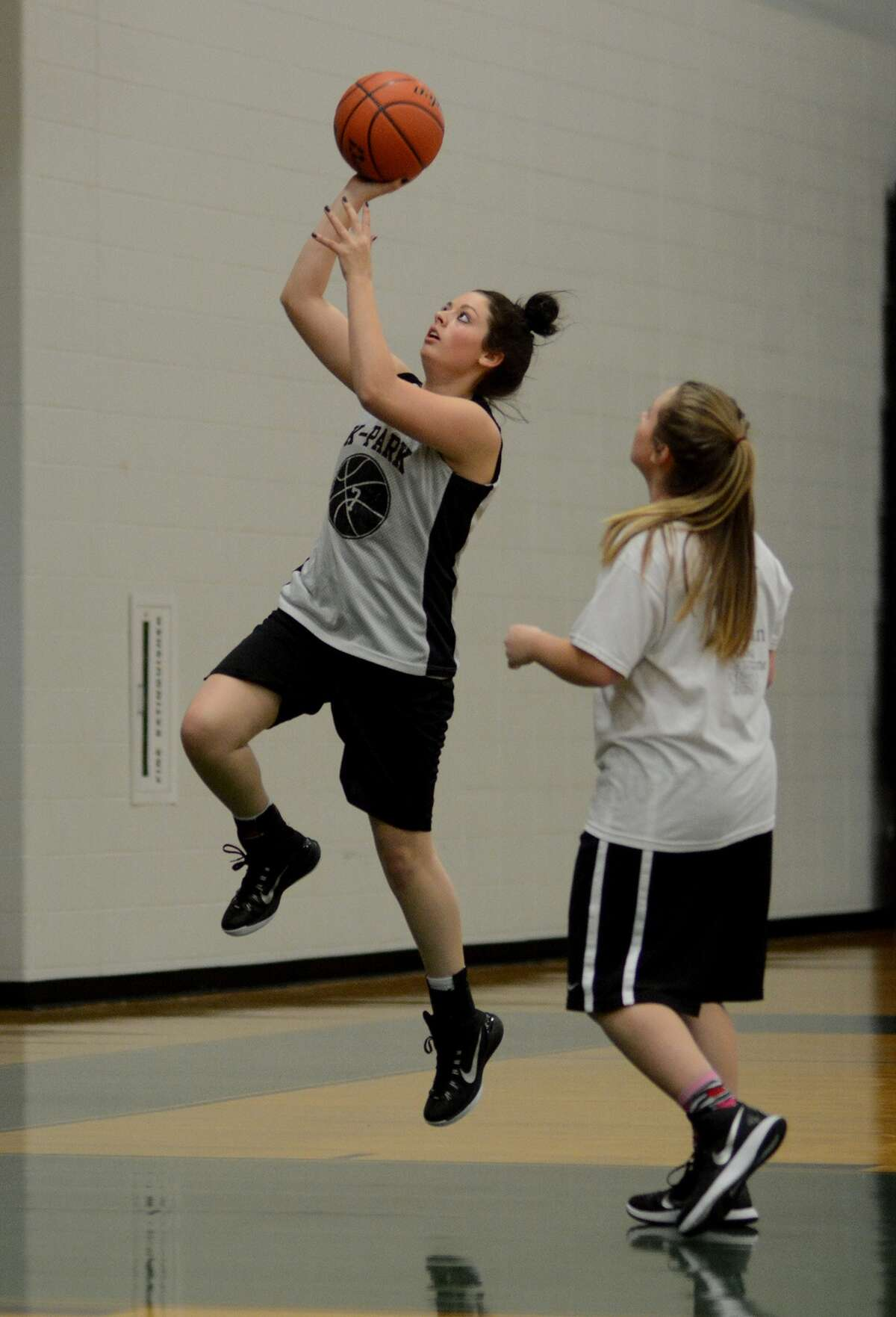 Kingwood Park senior Brooke Skero works during a lay-up drill at team practice on Jan. 26.