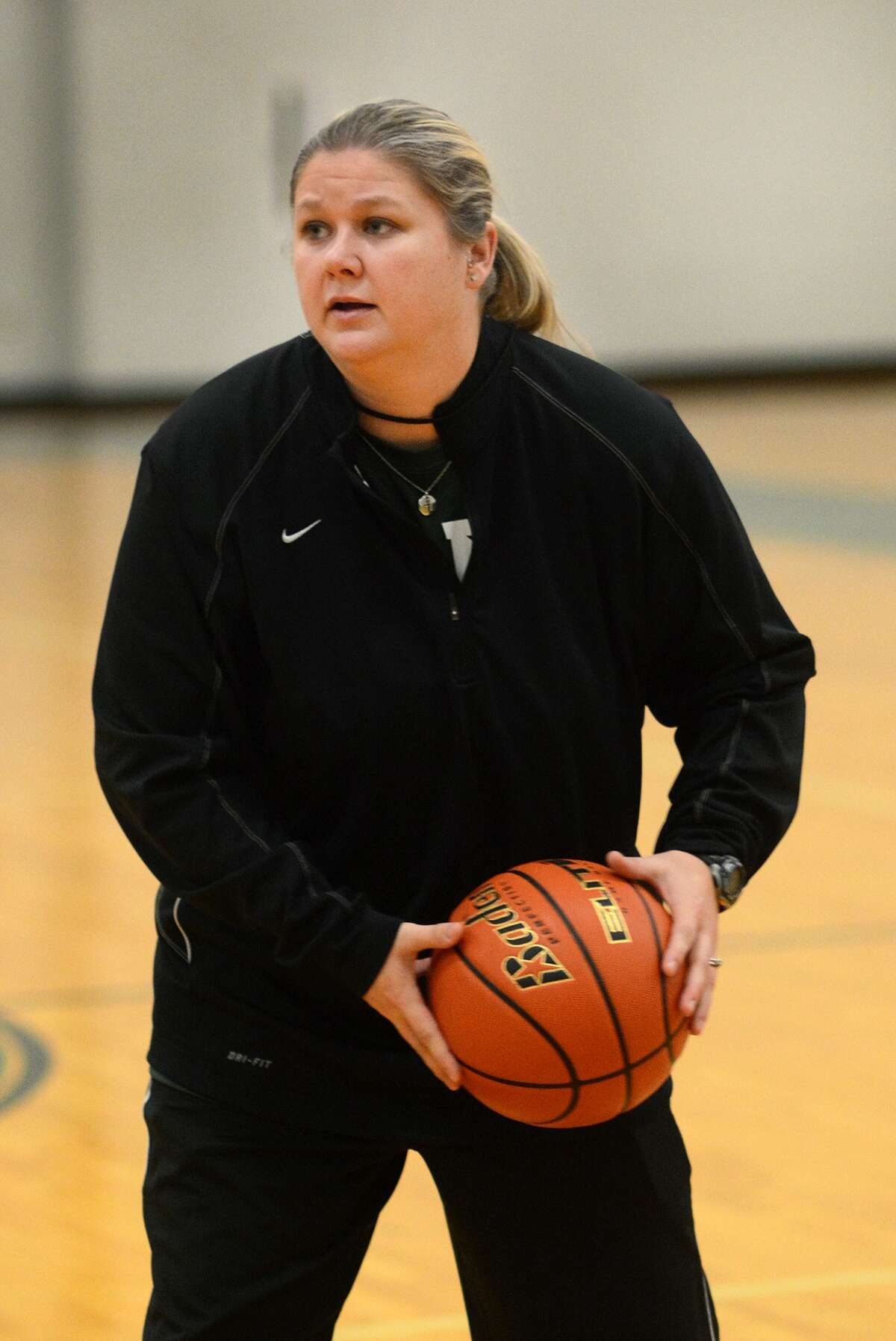 Kingwood Park Head Girls Basketball Coach LeighAnn Wolfe leads a drill during a team practice.