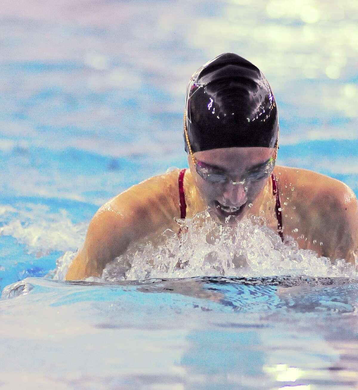 Elena Skaribas (junior at St. John's) competes in the Girls 100 Yard Breaststroke during the HAPPI Swimming and Diving Championships at Spring Branch Natatorium Saturday 01/25/14.