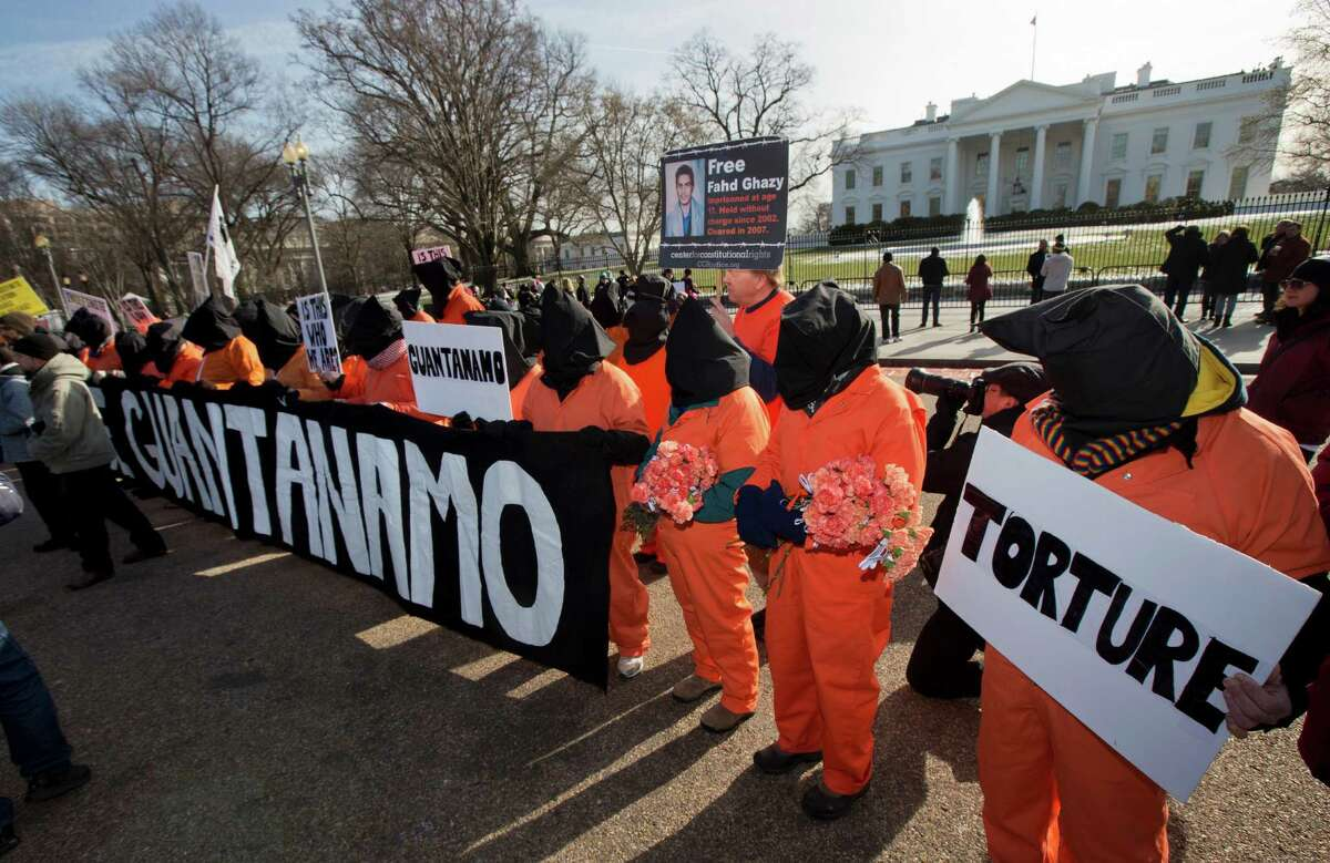 Protestors dressed as Guantanamo detainees gather in front of the White House, Sunday, Jan. 11, 2015, in Washington, during a rally to mark the 13th anniversary of detainees at Guantanamo Bay. (AP Photo/Manuel Balce Ceneta)