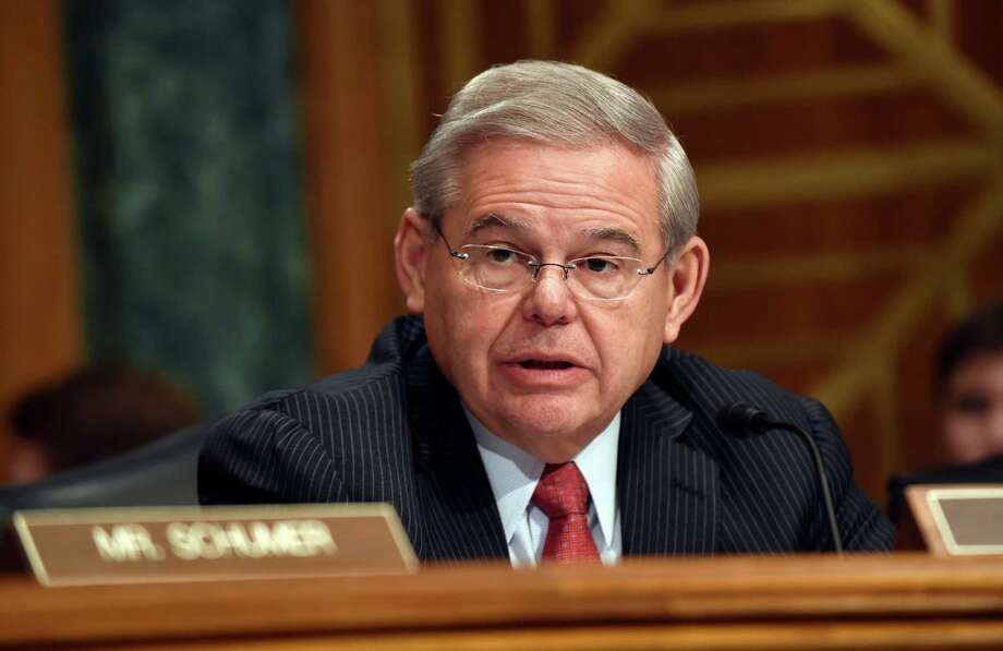 Senate Banking Committee member Sen. Robert Menendez, D-N.J. gives his opening statement on Capitol Hill in Washington, Tuesday, Jan. 27, 2015, during the committee's hearing on Iran sanctions. A group of Senate Democrats told the White House on Tuesday that they won't support passage of an Iran sanctions bill until at least the end of March. (AP Photo/Susan Walsh) Photo: Susan Walsh, STF / AP