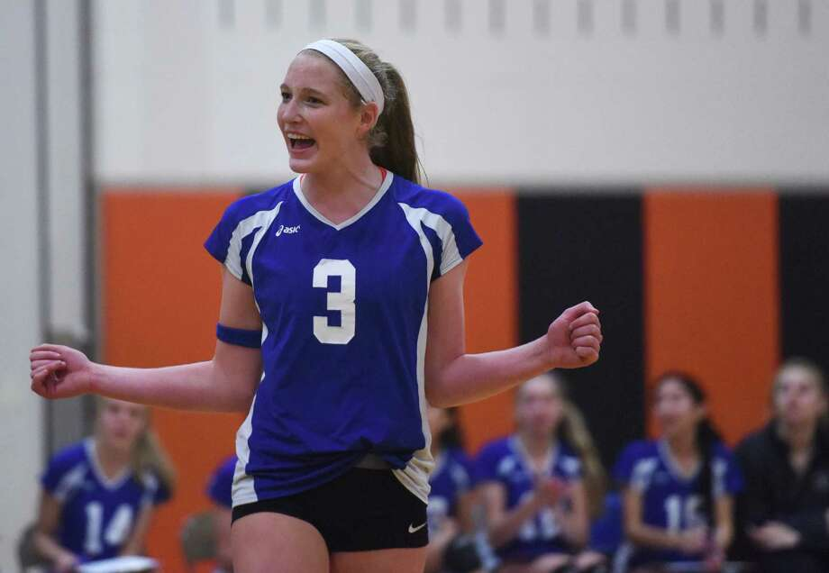 Isabelle Taylor celebrates Darien's 3-1 (23-25, 25-16, 25-12, 25-16) win over Fairfield Ludlowe in the CIAC Class LL girls volleyball semifinal game at Shelton Intermediate School in Shelton, Conn. Thursday, Nov. 13, 2014. Photo: Tyler Sizemore / Greenwich Time