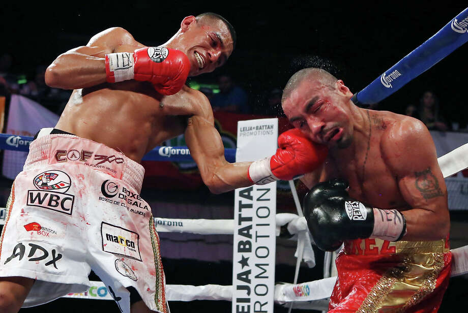 Robinson Castellanos (left) hits Rocky Juarez during their WBC Silver featherweight title bout on Jan. 26, 2015, at Cowboys Dancehall. Castellanos won by unanimous decision. Photo: Edward A. Ornelas /San Antonio Express-News / © 2015 San Antonio Express-News