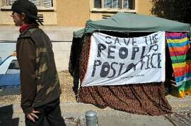 A tent sign in front of the Berkeley Post Office, now removed, notes one issue.
