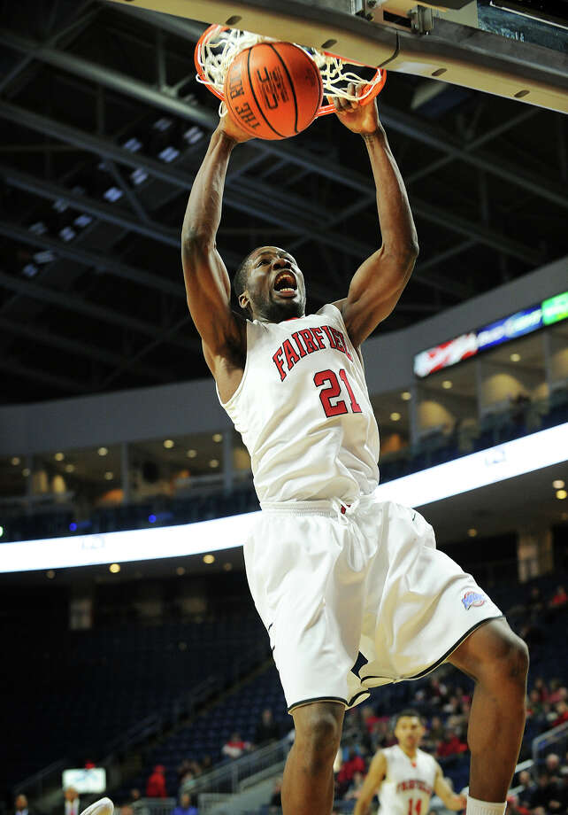Fairfield University sophomore center Amadou Sidibe slams home a dunk during the first half of the Stags' MAAC mens basketball game with Siena College at the Webster Bank Arena in Bridgeport, Conn. on Sunday, January 26, 2014. Photo: Brian A. Pounds / Connecticut Post