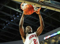 Fairfield University sophomore center Amadou Sidibe slams home a dunk during the first half of the Stags' MAAC mens basketball game with Siena College at the Webster Bank Arena in Bridgeport, Conn. on Sunday, January 26, 2014.