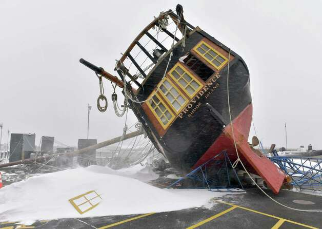 Rhode Island's tall ship, a replica of the USS Providence, rests on its side on the dock at at the Newport Shipyard after strong wind gusts topped it during the snowstorm Tuesday, Jan. 27, 2015, in Newport, R.I. Owner and captain Thorpe Leeson said the ship, stored there for the winter, sustained extensive damage. (AP Photo/Newport Daily News, Dave Hansen) ORG XMIT: RINEW102 Photo: Dave Hansen / Newport Daily News