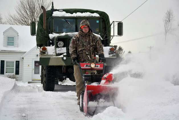 George Franek clears snow from his driveway in Terryville, Conn. during clean up of a winter storm on Tuesday, Jan. 27, 2015.  A major winter storm dropped a foot of snow or more over much of Connecticut, hitting hardest in the eastern part of the state.  (AP Photo/The Bristol Press, Mike Orazzi) MANDATORY CREDIT ORG XMIT: CTBRI101 Photo: Mike Orazzi / The Bristol Press
