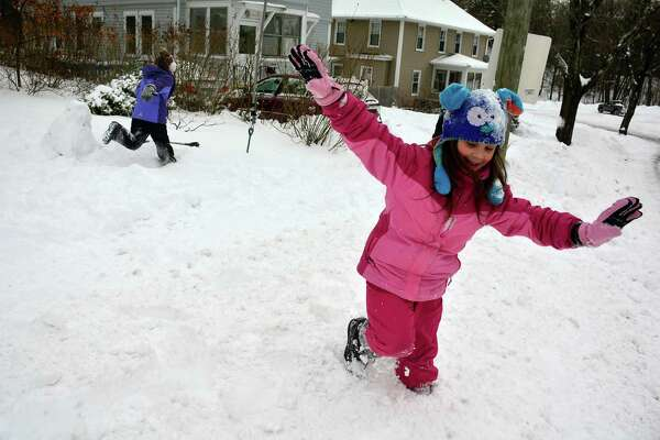 Brianna Vazquez,7, plays in the snow in Bristol, Conn., on Tuesday, Jan. 27, 2015. A major winter storm dropped a foot of snow or more over much of Connecticut, hitting hardest in the eastern part of the state. (AP Photo/The Bristol Press, Mike Orazzi) ORG XMIT: CTBRI104
