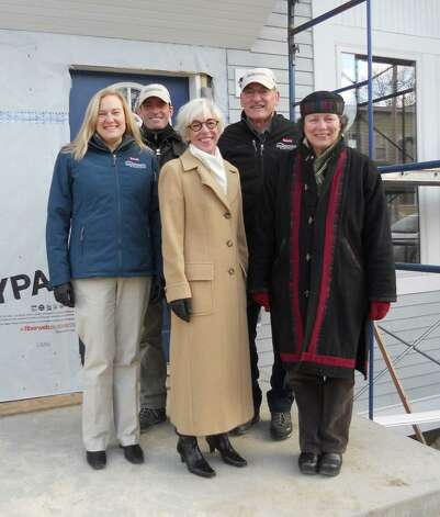 Columbia County Habitat for Humanity Executive Director Brenda Adams announced that Ed Herrington Inc., the family-owned supplier of lumber, millwork and building supplies, has contributed $10,000 to support Habitat's current construction project, two new Passive Townhouses at 208-212 Columbia Street in Hudson.(Submitted photo)