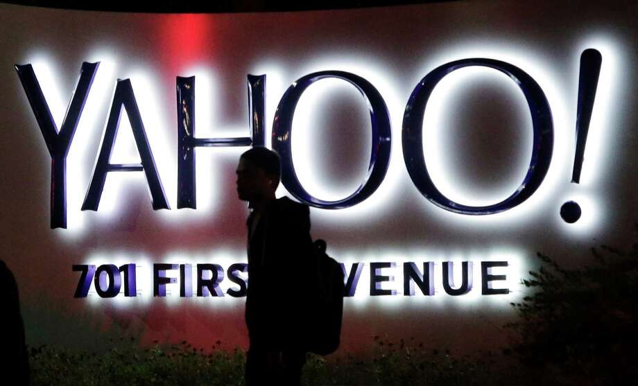 In this Nov. 5, 2014 photo, a person walks in front of a Yahoo sign at the company's headquarters in Sunnyvale, Calif. Yahoo reports quarterly financial results on Tuesday, Jan. 27, 2015. (AP Photo/Marcio Jose Sanchez) Photo: Marcio Jose Sanchez, STF / AP