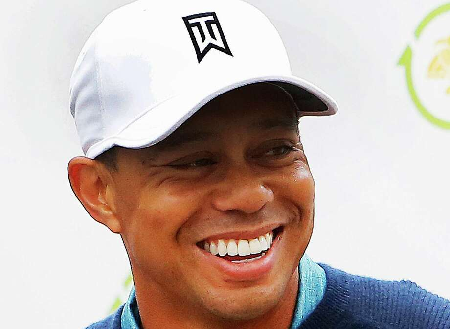 Tiger Woods was flashing a perfect smile Tuesday after some recent dental work. Photo: Rick Scuteri, FRE / FR157181 AP