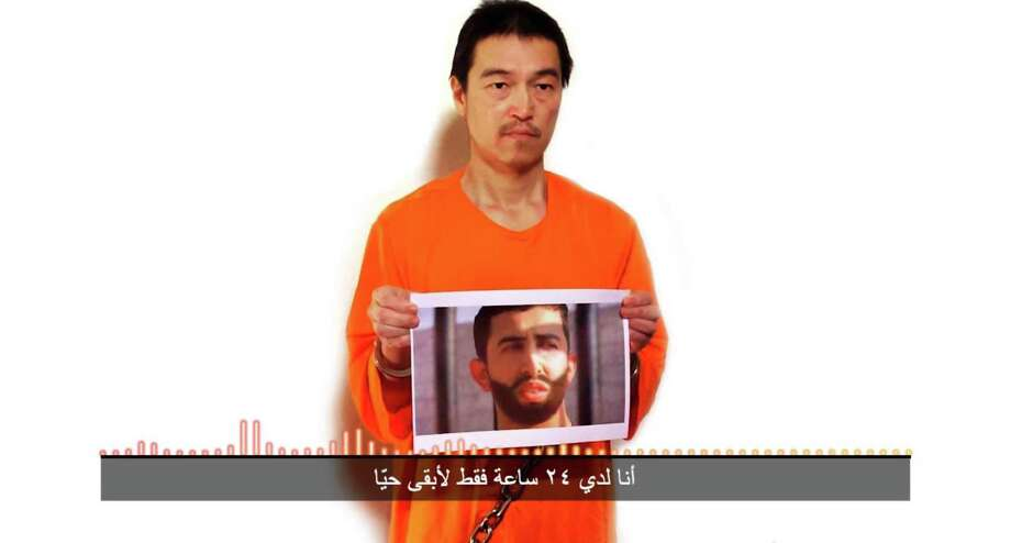"""This still image taken from a video posted on YouTube by jihadists on Tuesday, Jan. 27, 2015, shows a still photo of Japanese journalist Kenji Goto holding what appears to be a photo of Jordanian pilot 1st Lt. Mu'ath al-Kaseasbeh. Both are being held hostage by the Islamic State militant group. The still image was overdubbed with audio in which Goto delivers a message from the militants demanding the release of Sajida al-Rishawi, an Iraqi woman sentenced to death in Jordan for involvement in a 2005 terror attack that killed 60 people. The Arabic subtitle reads """"I only have 24 hours left to live."""" The Associated Press could not independently verify the video. (AP Photo) Photo: HONS / YouTube"""
