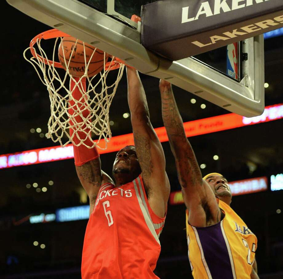 Terrence Jones dunks against the Lakers in the season opener, one of four games he played before being sidelined with a nerve issue. Photo: ROBYN BECK, Staff / AFP