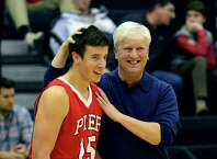 Fairfield Prep Head Coach Leo Redgate with player Joseph DiGennaro, during boys basketball action against Career Magnet in New Haven, Conn., on Wednesday Jan. 14, 2015.