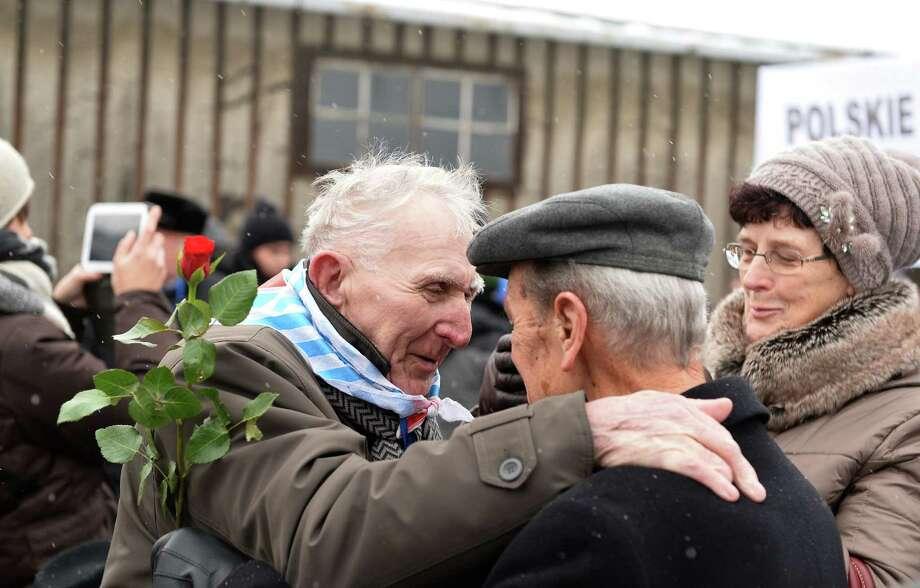 Holocaust survivors greet each other as they gather on the 70th anniversary of the liberation of Auschwitz, a Nazi death camp in Oswiecim, Poland. Photo: JANEK SKARZYNSKI, Staff / JANEK SKARZYNSKI
