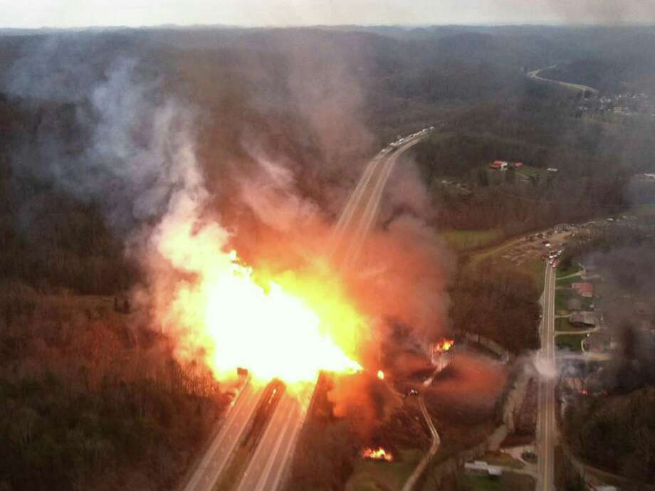 FILE - In this image Dec. 11, 2012 file photo, provided by the West Virginia State Police, shows a fireball erupting across Interstate 77 from a gas line explosion in Sissonville, W.Va. Accident investigators issue a report and safety recommendations based three powerful gas transmission line explosions in California, Florida and West Virginia. In each case, the gas company failed conduct inspections or tests that might have revealed weaknesses in the massive pipelines. In the California accident, 9 people were killed and 70 homes destroyed. In the West Virginia incident, the stretch of pipeline that ruptured, igniting a fire that destroyed three homes and damaged several others, hadn't been inspected or tested for 24 years.   (AP Photo/West Virginia State Police) Photo: Uncredited, HOPD / West Virginia State Police