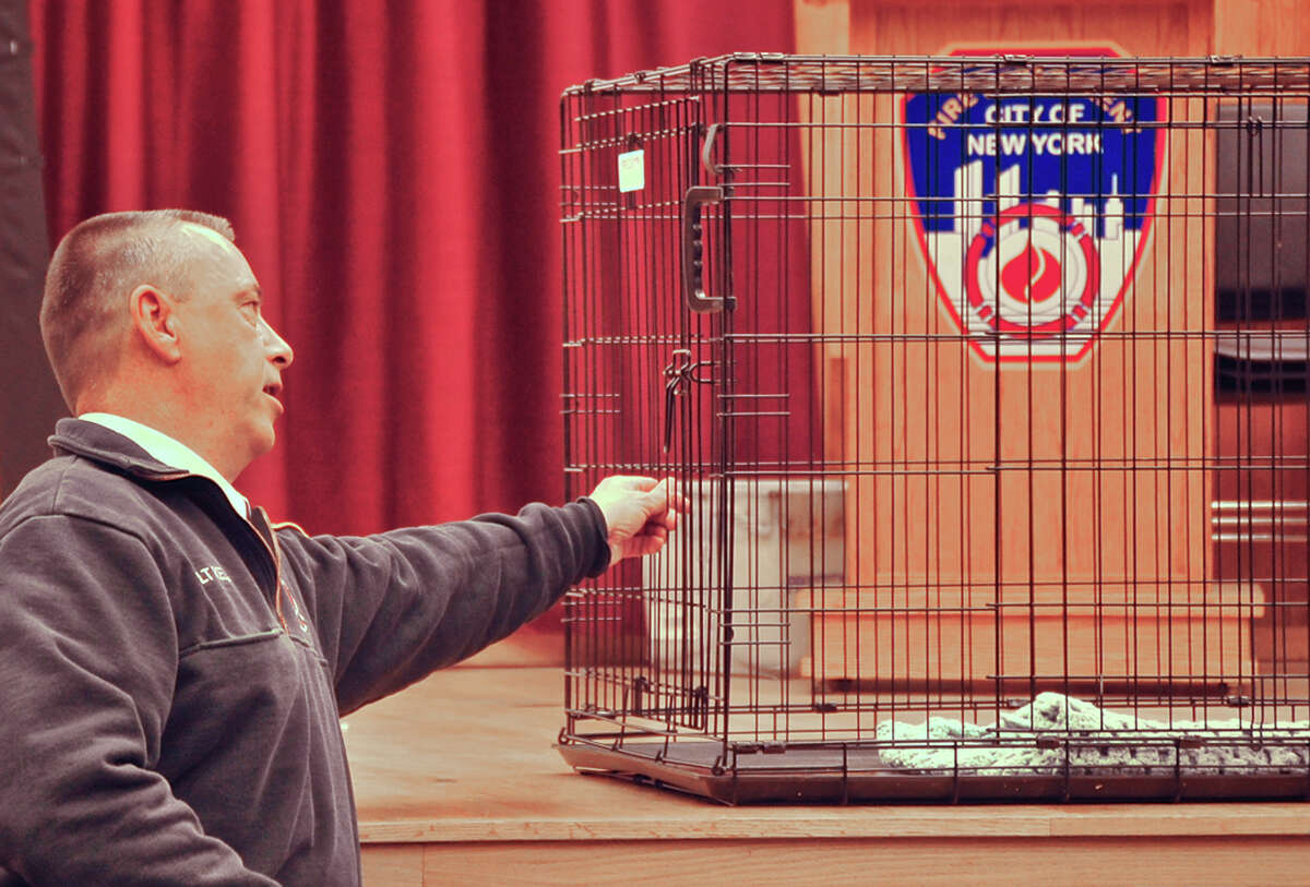 Fire Department of New York firefighter David Kelly shows off the cage he used to catch a whippet at the FDNY's training facility on Randall's Island in New York on Tuesday, Jan. 27, 2015. The young dog, named Burt, vanished on the streets of New York City after wandering off near his Upper Manhattan home in August. About a month ago, he was spotted near the firefighting facility on the island in the East River. Kelly worried about the dog's safety in the recent approaching snowstorm and set a trap by putting the food in a cage, which worked. After scanning the Internet for missing whippets, Kelly found Burt's Facebook page and returned the dog to his owner. (AP Photo/FDNY) ORG XMIT: NYR103