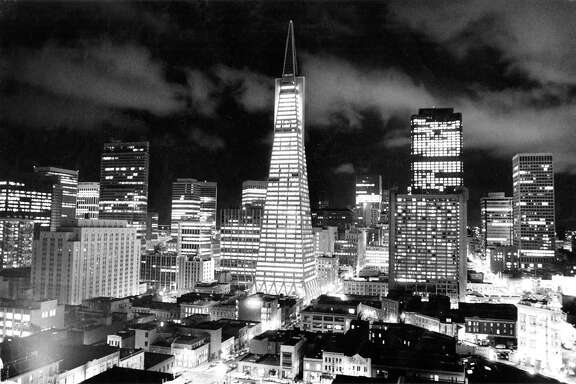 "Jan. 30, 1974: The Transamerica Pyramid was just two years old when Chronicle photographer Jerry Telfer took this photo from the the roof of some apartments on Vallejo Street. At the time residents were upset about the ""Manhattanization"" of downtown San Francisco, but at night, this skyline was easy to love."